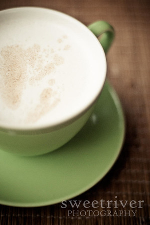chai latte on green saucer